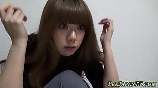Asian teen pees in toilet