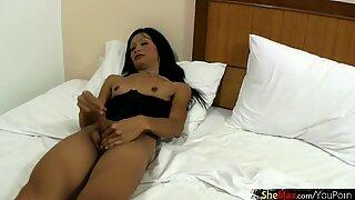 Petite ladyboy in black lingerie sucks big white dick
