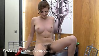 Zlata masturbates with a red pepper on a table