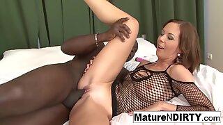 dark haired mummy masturbates before taking a big black cock