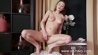 Irene masturbates her hairy pussy