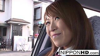 Hot Japanese babe fucks him in the car