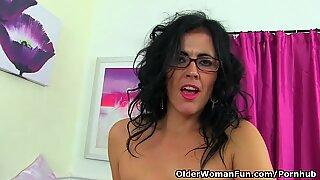 Spanish milf Montse Swinger undresses nylon and drills faux-cock