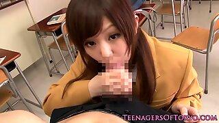 Kinky Jap schoolgirl blows cock in classroom